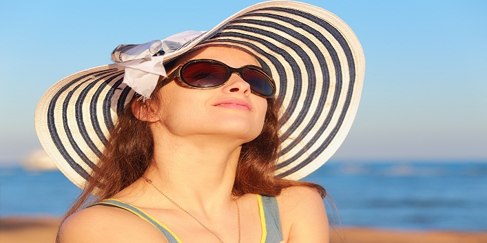 Beautiful Woman In Hat And Sun Glasses Looking Up And Joy On Blu