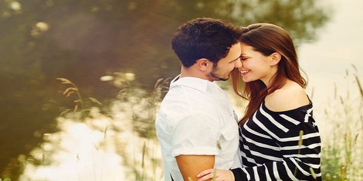 happy romantic sensual couple in love together outdoors on summer vacation