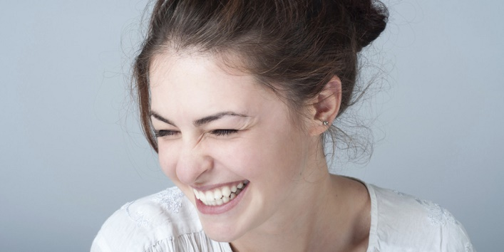 young woman portrait with a toothy smile