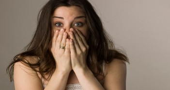 Shocked woman covering mouth