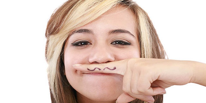 Attractive girl with mustache, using her finger