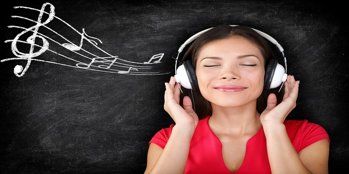 Happy woman listening to music from mobile phone at home ... |Woman Listening To Music