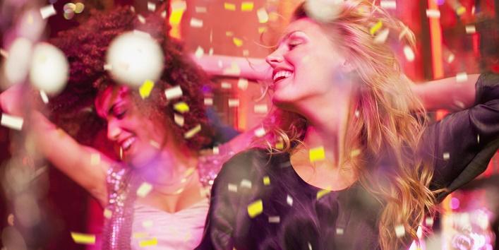 Friends dancing in nightclub